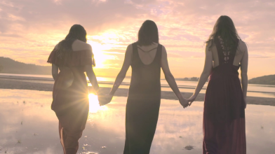 videoblocks-women-hold-hands-and-walk-into-water-their-backs-to-camera-at-sunset_rzq6koere_thumbnail-full03
